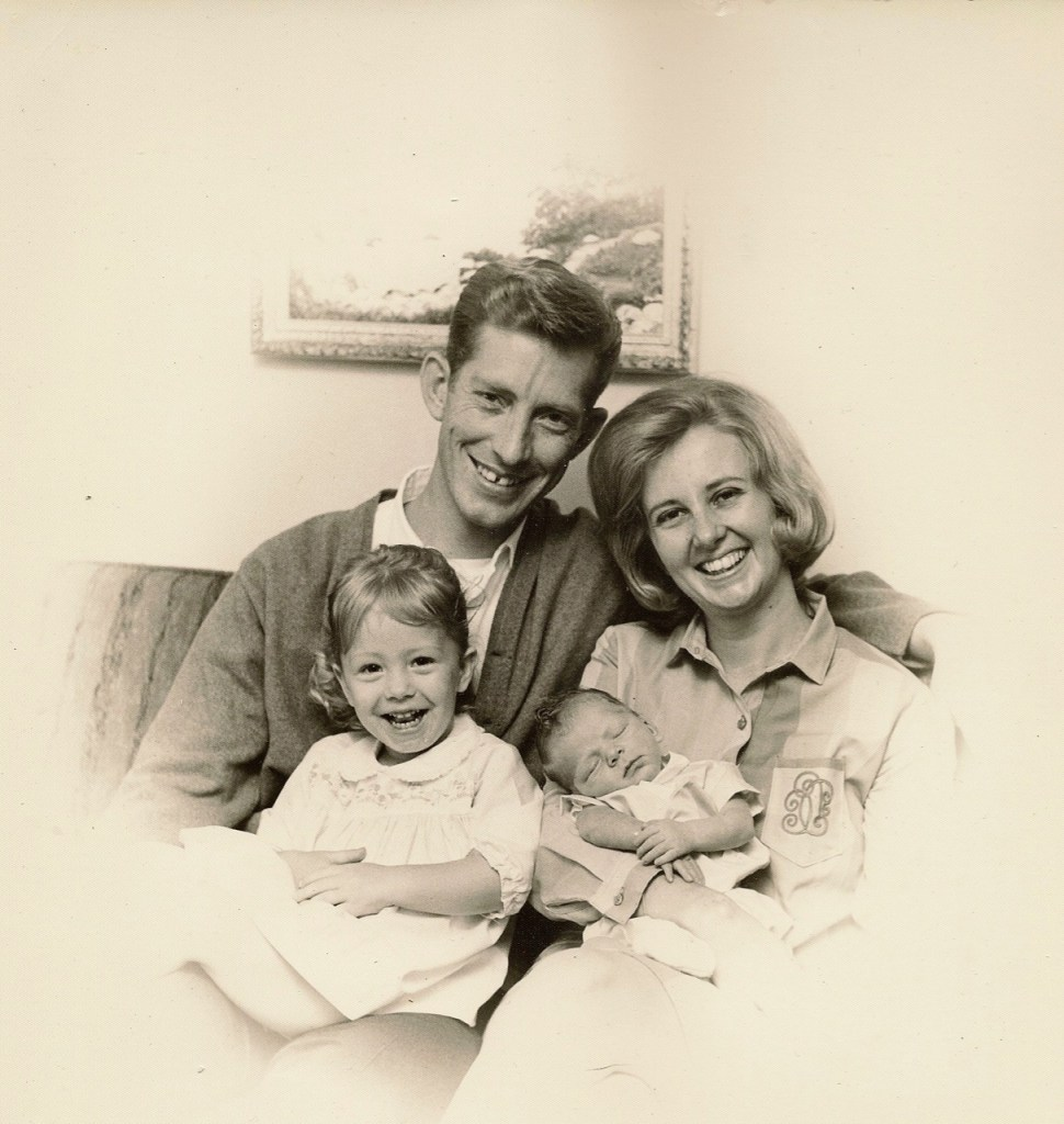 Black and white photo of family with young children in the early 60s