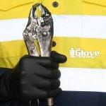 Tradesmen holding wrench wearing TGC Black Nitrile Gloves