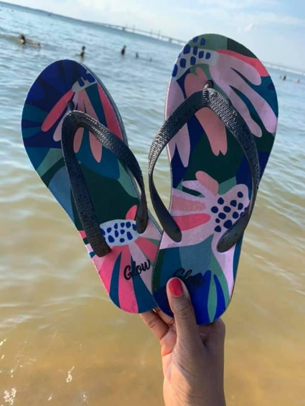 glow flip flops on the beach