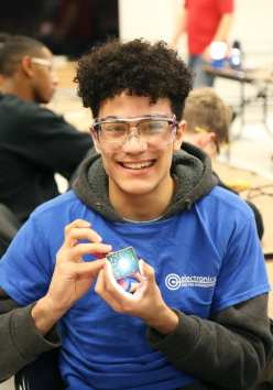 GLTS junior, Adoni Jimenez, of Lawrence, from the engineering shop, works on soldering the circuit for the solar light. (Courtesy Photo GLTS)