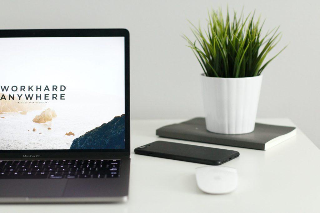 Laptop and phone on desk GLT Web Design