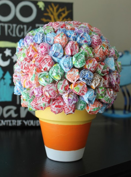 A Halloween lollipop tree is a cute seasonal decoration for your home as well as a fun way to pass out candy on Halloween to trick or treaters!
