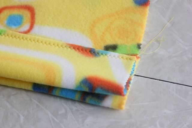 Make a pillowcase in 3 steps out of fleece. It's the perfect project for someone new to sewing and the perfect beginning sewing project for kids!