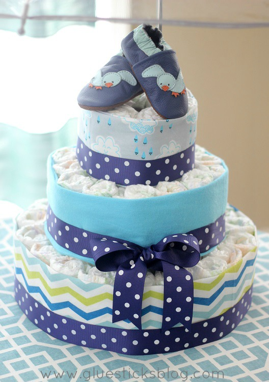 A fresh and beautiful April showers baby shower theme full of color and whimsy! Complete with rain boot centerpieces, a DIY cloud wall hanging and an umbrella diaper cake!