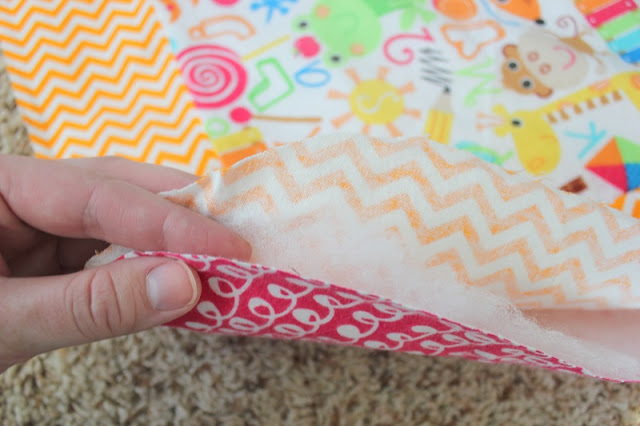 A quick and easy baby quilt tutorial for those who don't consider themselves to be quilters! This blanket comes together incredibly fast! Use pre-packaged bias tape or make your own binding. It's up to you!