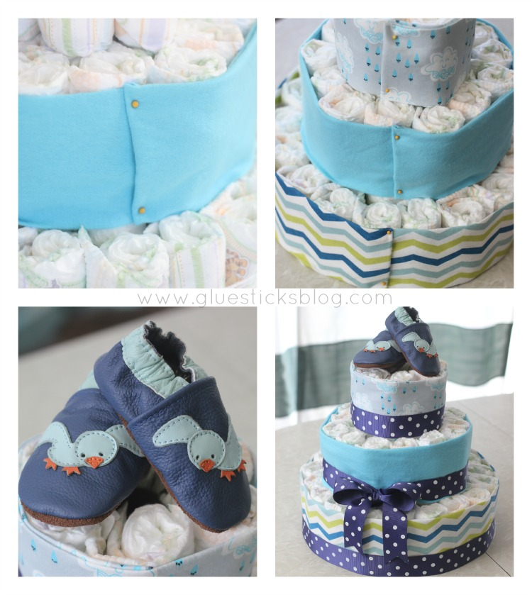 An April Showers diaper cake for a springtime baby shower. Complete with diapers, shoes, and receiving blankets.