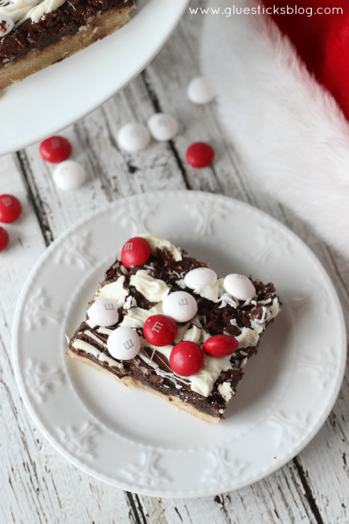 These black and white peppermint brownies combine a sugar cookie, brownie,two types of chocolate, and M&Ms White Chocolate Peppermint Candies. Absolutely beautiful and perfect to give to friends this holiday season!