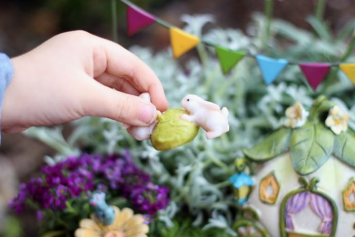 A darling fairy tale fairy garden, complete with a carriage! This little garden is what little girl dreams are made of.