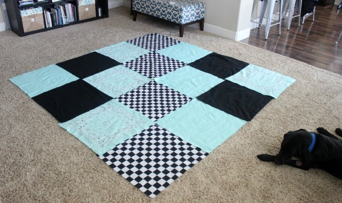 unsewn bandannas places in a 4x4 grid on floor