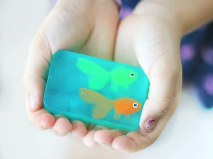 Melt and pour soap made from glycerin soap blocks! These little fish soaps are easy for kids to make and fun to customize with different scents! An awesome gift idea or summer craft for kids!