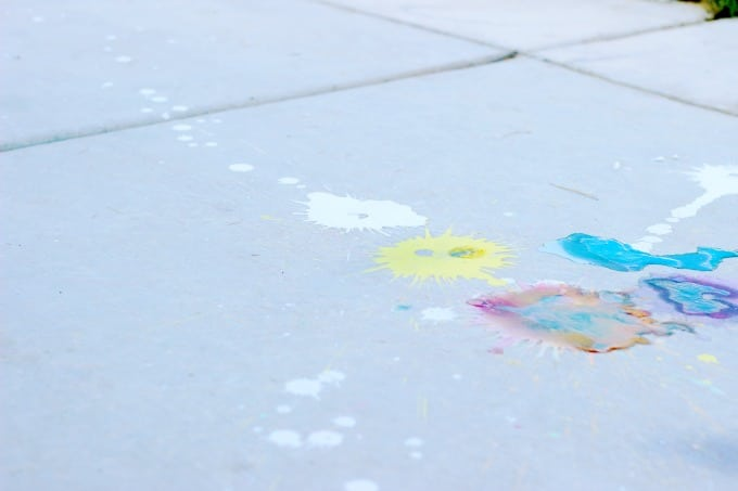 A science experiment, crowd pleaser, and boredom buster all in one! These sidewalk paint rockets splatter colorful bursts of chalk paint on the ground and clean up with water!