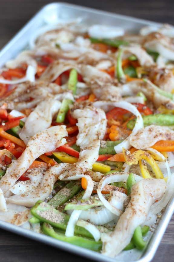 Seasoned chicken, bell peppers, onions, and sliced chicken all baked together on a sheet pan for the perfect blend of flavors. Ovenfajitas are a greatweeknight meal. Serve with warm flour tortillas, guacamole, and sour cream.