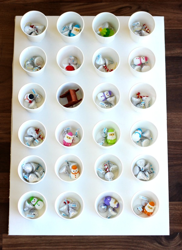 A simple DIY advent calendar made from paper cups and tissue paper. Kids can break open the tissue each day to find the surprise inside!