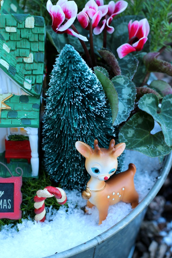 A beautiful Christmas fairy garden to brighten your porch or home this holiday season! Get the kids involved for a magical project that will last all season!