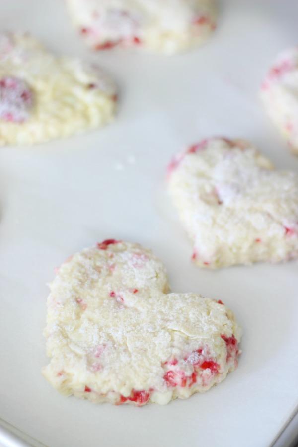 raspberry scones on baking sheet