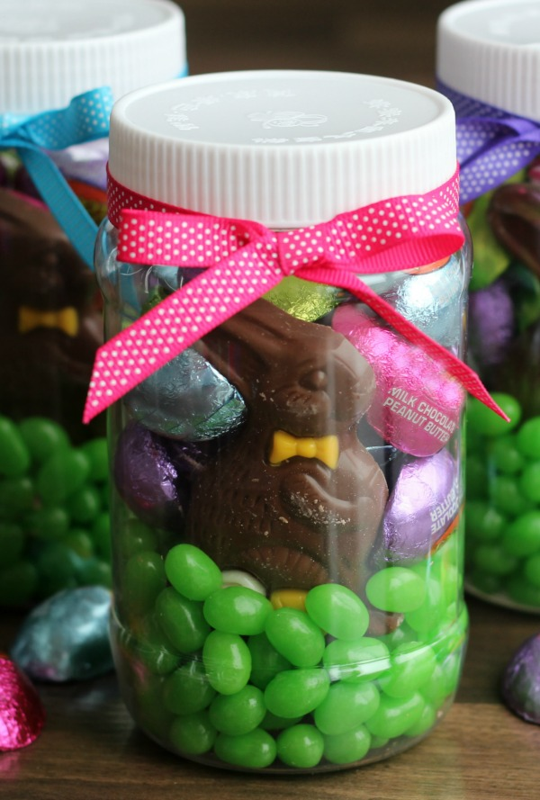 Easter mason jar filled with candy and a chocolate bunny a darling easter in a jar your favorite seasonal candies all neatly packaged in a plastic easter negle Images