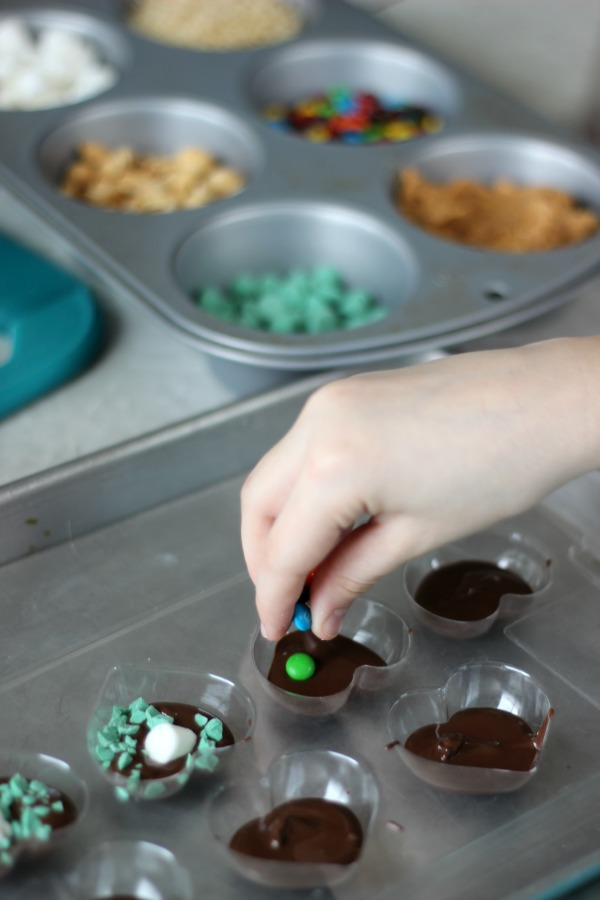 Raid the pantry to see what fun add-ins you can find for your own chocolate candies! Kids love making their own food and these DIY chocolate candies are super easy...and yummy!