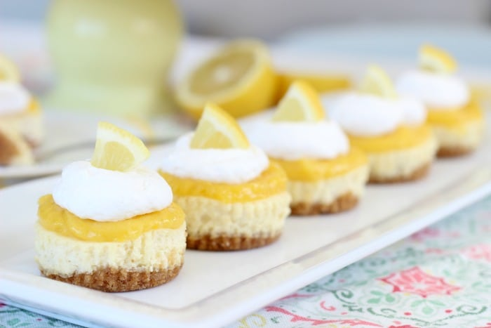 This homemade lemon curd cheesecake recipe has a sweet NILLA Wafers crust and a creamy cheesecake filling. Topped with a homemade lemon curd, and whipped cream. The perfect combination of sweet and tangy, they are little in size, but huge in flavor!