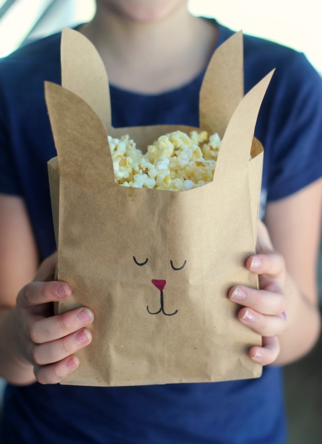 Turn paper lunch sacks intobunny treat bags with just a few snips of the scissors. A quick and easy way to make your nextmovie night even more fun!