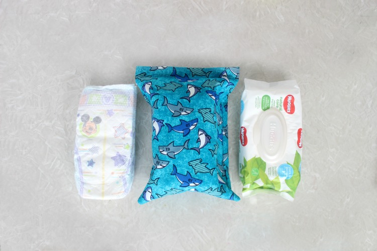 This diaper changing pouch is an easy 15-minute sewing project. It holds 3 diapers, a package of wipes, and even has room for diaper cream or other small items! Every mom needs one so make a few to keep on hand as baby shower gifts!