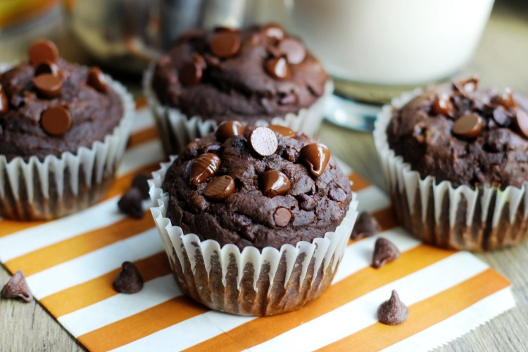 A FAVORITE recipe in our home that will sure to be a hit in yours, too. These chocolate pumpkin muffins combine pureed pumpkin, pumpkin spice, and chocolate in the best way possible.