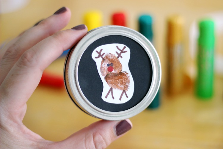 Capture your child's darling little thumbprint in this cute and easy reindeer ornament! A quick, low-mess, activity for toddlers and preschoolers.