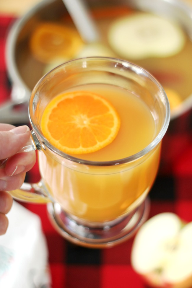 This holiday spice wassail recipe not only tastes delicious but makes your home smell amazing as it simmers! Prepare over the stove or in a slow cooker.