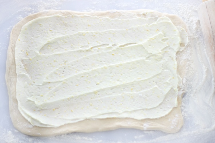 quick and easy lemon sweet rolls rolled out spread with frosting