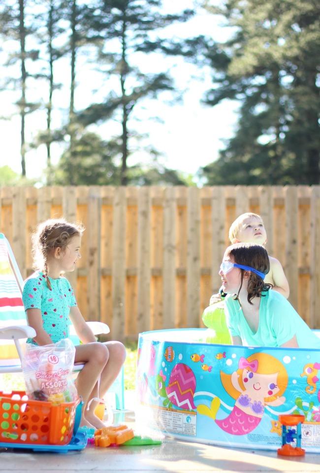backyard activities for kids: kids sitting poolside