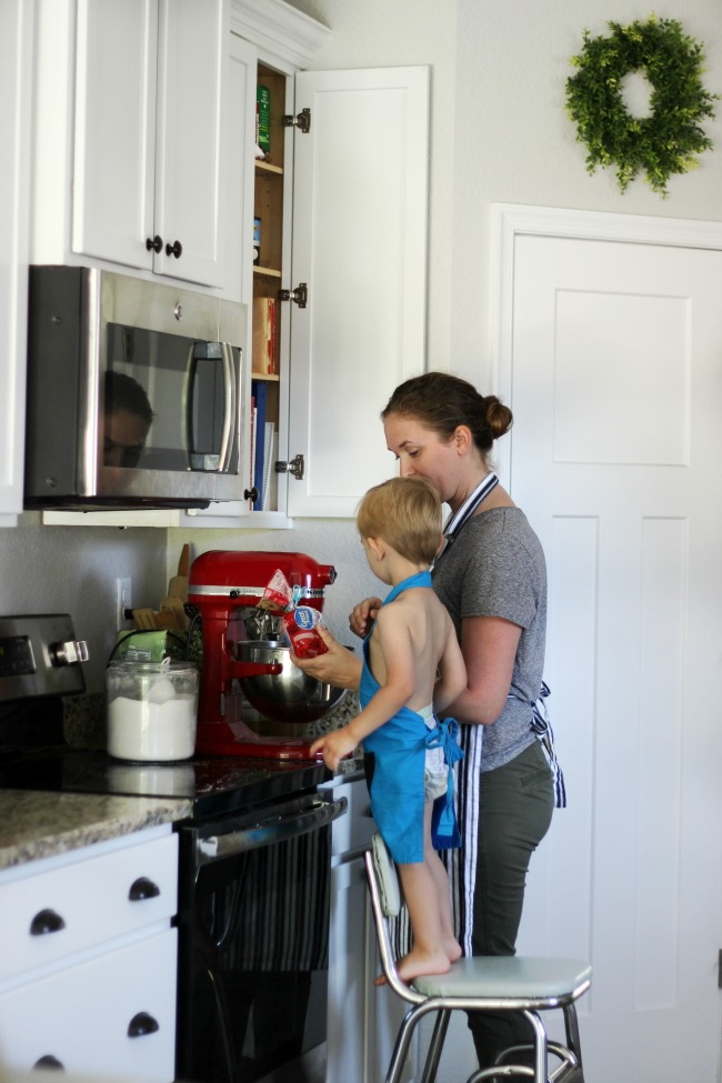 mom and toddler baking cookies