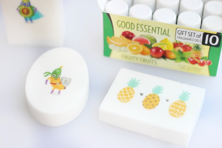 two bars of tattoo soap next to box of fruit scented oils