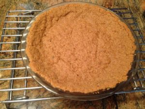 Gluten Free Grandma T's quick and easy recipe for gluten free graham cracker crust is remarkably tasty and holds up well for cheesecake or pie.