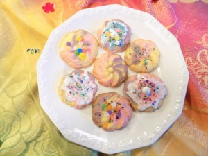 """Rainbow, or """"unicorn"""" food seems to be everywhere these days! To this end, Grandma T and I created these magical gluten free spritz cookies."""