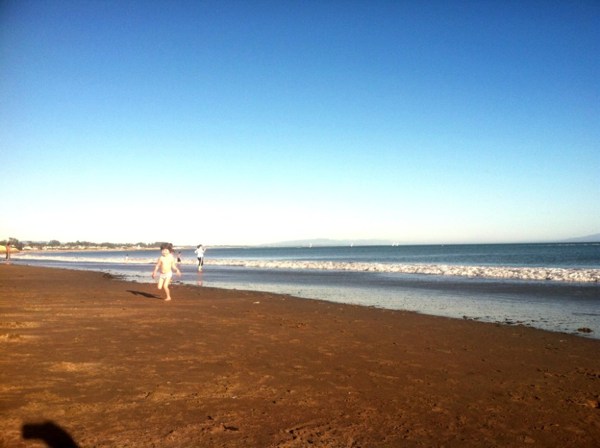 Lu running at the beach