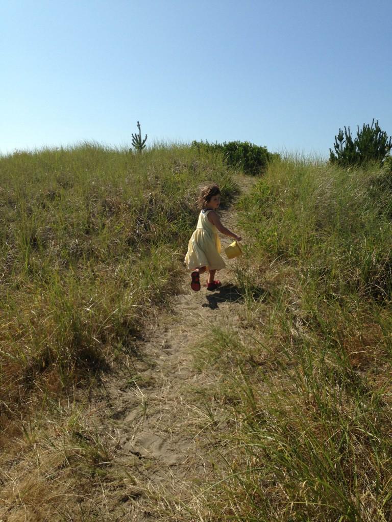 Lucy running toward the beach
