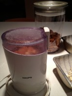 Grinding the almonds in a coffee mill