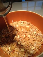 Pouring the oil and honey into the rice crisps, seeds, and nuts