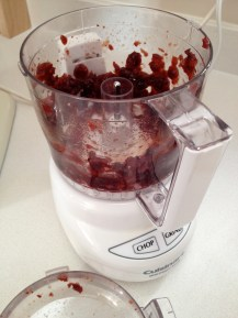 Pulsing the softened cranberries in a mini-processor