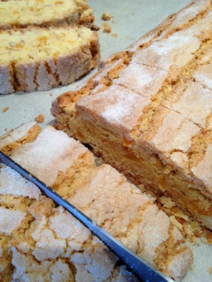 Laying the biscotti on their edges as the cutting continues