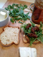 Brie, almond butter, arugula, jam