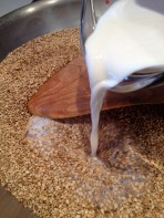 Adding the milk to the toasted seeds