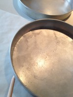 Tracing the circumference of the baking pan on parchment paper