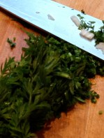 Mincing the carrot tops