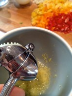 Adding the garlic to the lemon juice and zest