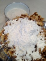 Preparing to pulse the walnuts with a portion of flour