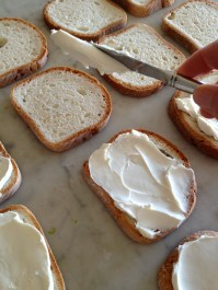 Spreading the cream cheese
