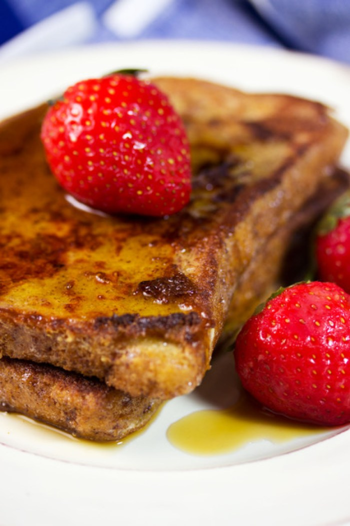 close up of delicious french toast topped with strawberries