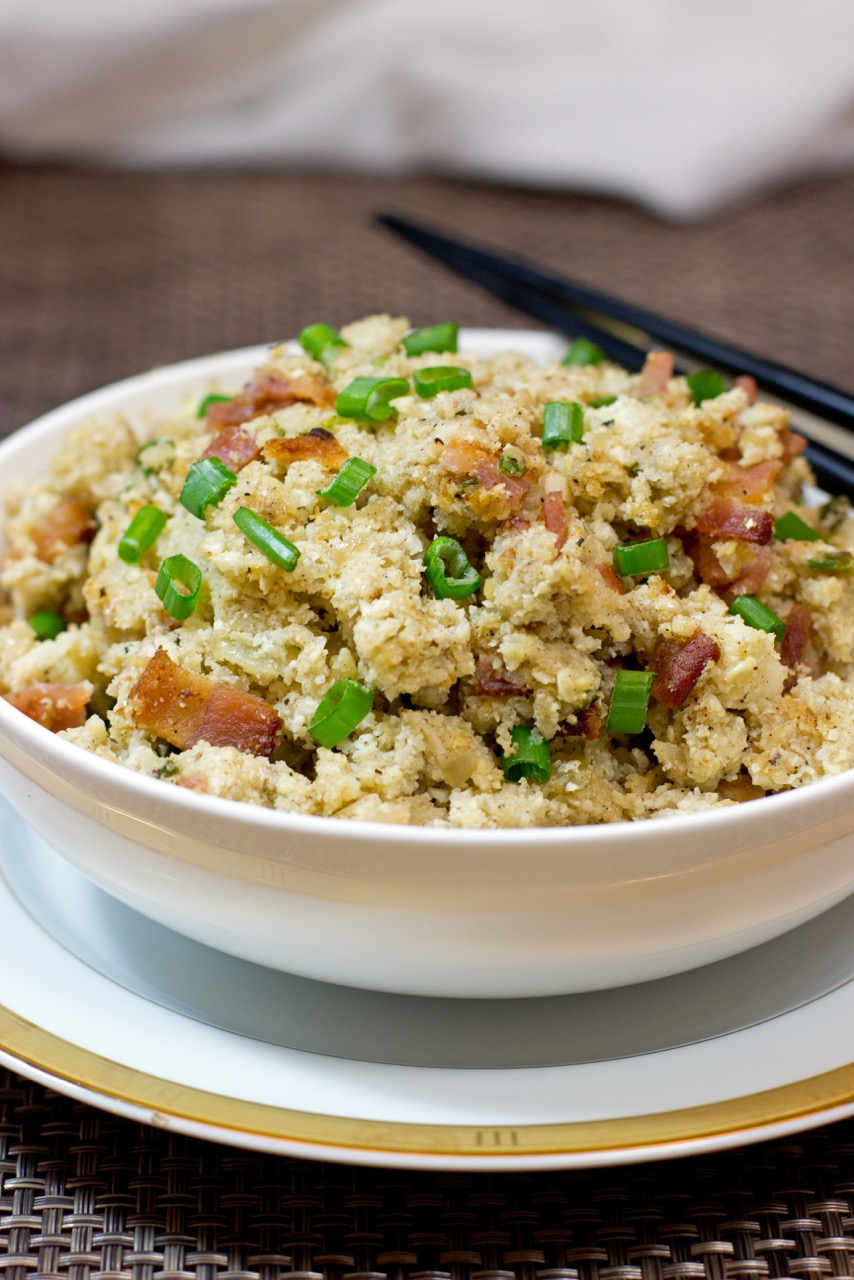Close up of cauliflower rice with bacon in a bowl