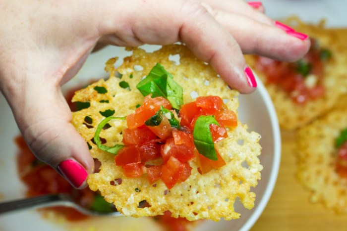 Woman's hand holding a finished appetizer
