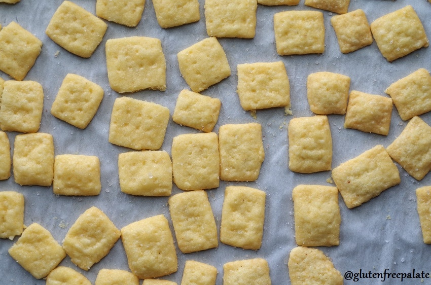 top dow view of gluten free cheese crackers on a parchment lined baking sheet